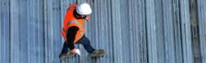 man inspecting flat roof